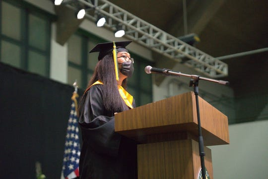 University of Guam Class of 2020 valedictorian Megan Gimmen at the podium during the UOG commencement ceremony