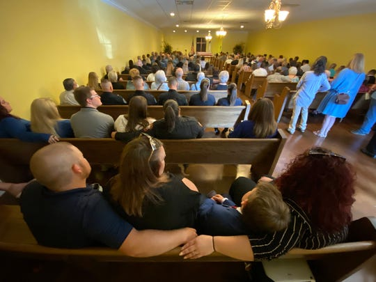 Mourners fill a chapel and overflow rooms at Tutor Funeral Home while attending the funeral service for fallen Simpson County Deputy James Blair in Mendenhall, Miss. on Wednesday, June 17. Blair was allegedly shot to death by a man in his custody while Blair was transporting him to a mental health facility on June 12, 2020.