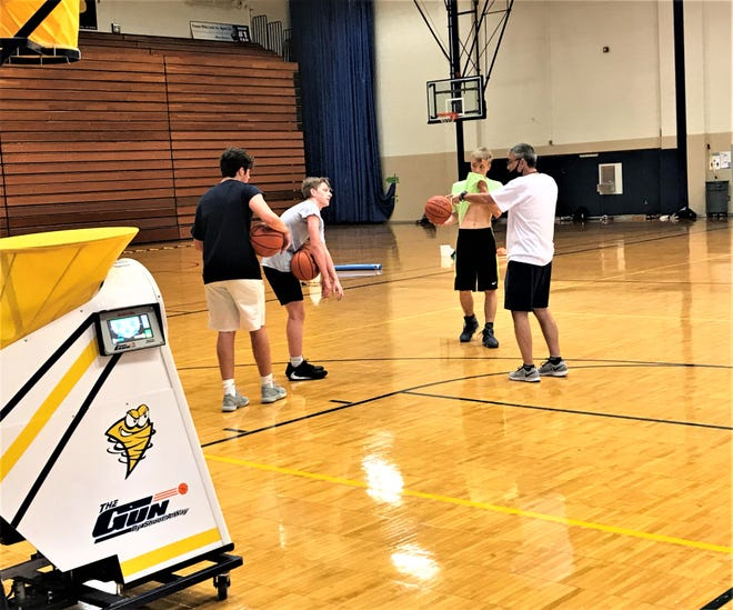 Lancaster boys basketball coach Kent Riggs gives his players instructions during a workout Tuesday morning at Lancaster High School.