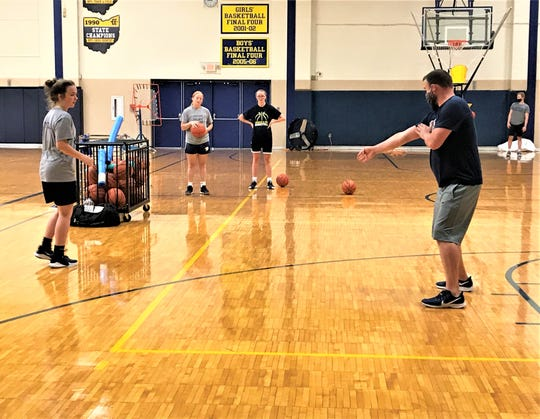 Lancaster girls basketball coach Dusty Miller gives instructions to his players during a drill Tuesday morning at Lancaster High School.