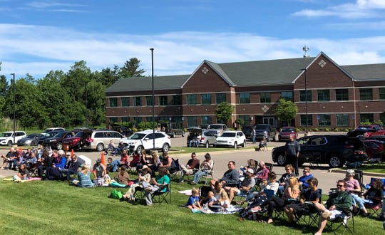 Members of the Well Church in Genoa Township gathered outside for a service on June 14, 2020.