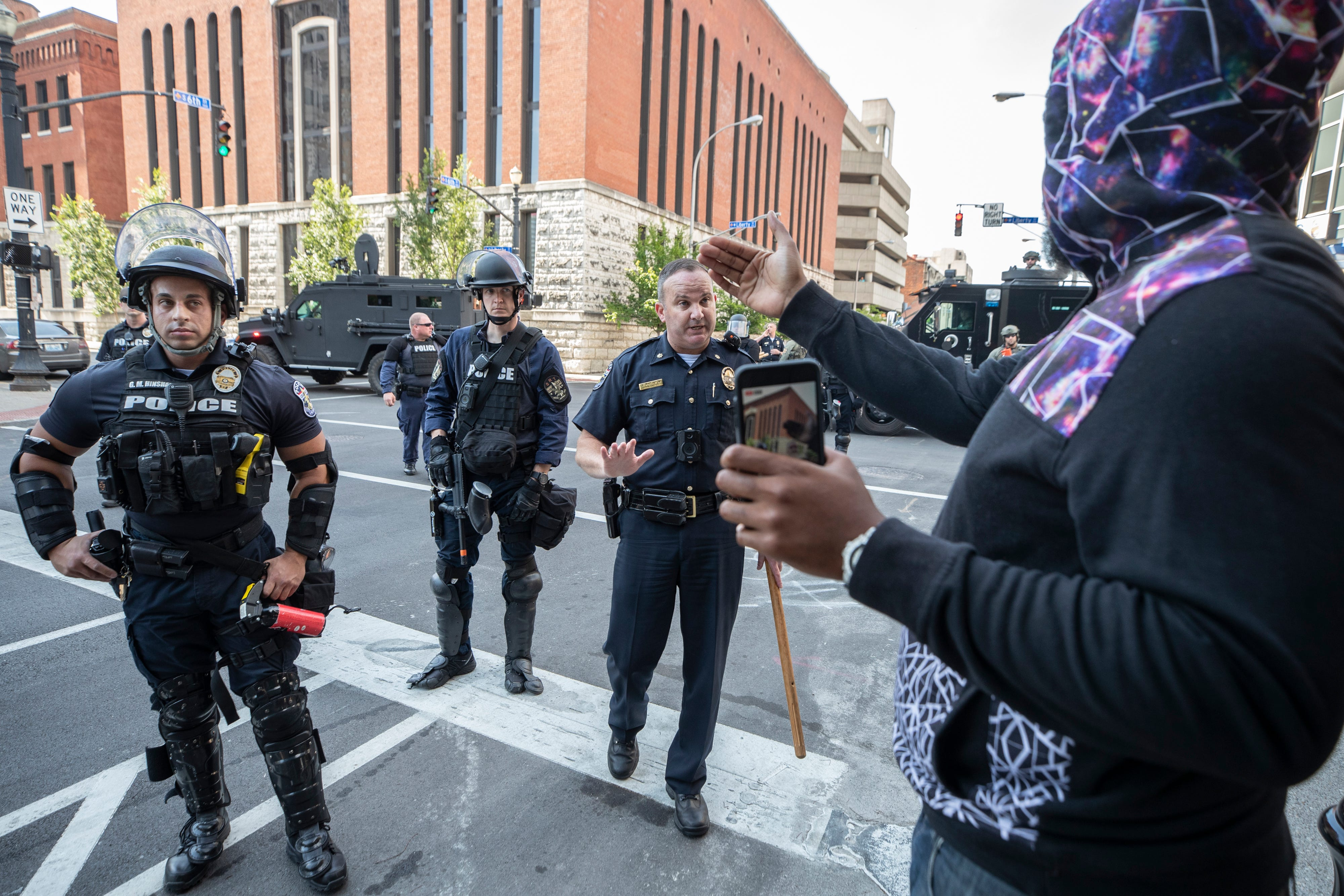 A protester talks with Louisville Metro police following a confrontation near Jefferson Square in downtown Louisville, Kentucky. June 17, 2020