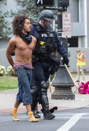 Steven Lopez is arrested on June 17 after an attempt by protesters to block Liberty Street. Lopez was charged with murder on Sunday, June 28, in connection with a fatal shooting Saturday night.