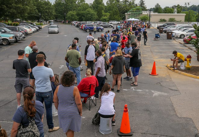 Hundreds wait in line to get their unemployment insurance claims resolved at the education center at the Kentucky State Capitol on Wednesday, June 17, 2020.