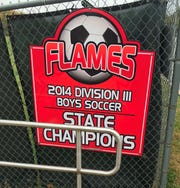 A banner outside of Comstock Field commemorates the 2014 Mansfield Christian Flames state championship team.