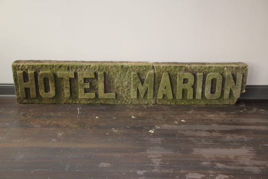 This antique sign will be incorporated into the decor of the Center Street Market, according Cliff Edwards, CEO of the Center Street Community Health Center, which is developing the market.