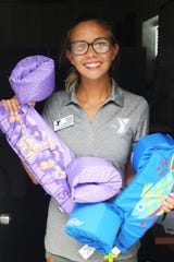 Morgan Joseph holds some child inflatable devices she secured for her swim lessons.
