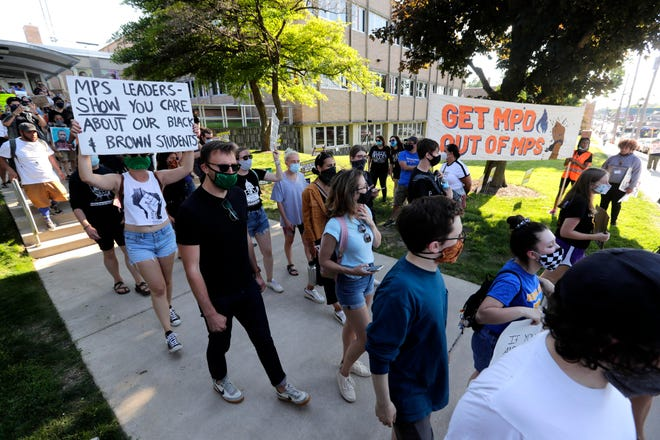 Demonstrators gather outside Milwaukee Public Schools administrative offices Wednesday to support a resolution ending district contracts with the Milwaukee Police Department for resource officers.