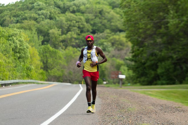 Coree Woltering runs along a connecting route of the Ice Age Trail in Wisconsin while trying to set a fastest known time record on the trail in June 2020.