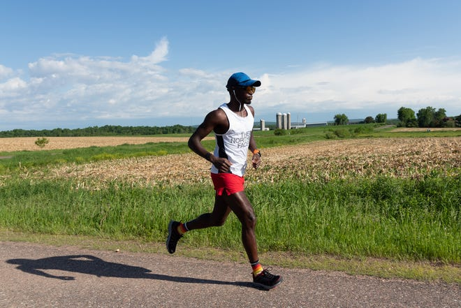 Coree Woltering runs along the Ice Age Trail in Wisconsin while trying to set a fastest known time record on the trail in June 2020.