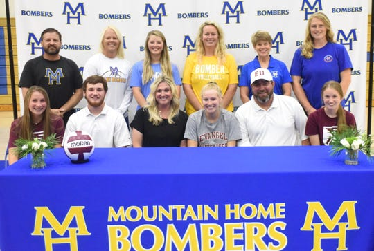 Mountain Home's Leah Jackson signed a National Letter of Intent recently to play volleyball at Evangel University in Springfield, Mo. Pictured at Jackson's signing ceremony Wednesday afternoon are (first row, from left) Cate Jackson, Luke Jackson, Lee Anne Jackson, Leah Jackson, Craig Jackson, Cara Jackson; (back row) Lady Bomber head basketball coach Dell Leonard, Junior Lady Bomber basketball coach Lindsey Leonard, Junior Lady Bomber volleyball coach Shelby Upshaw, Lady Bomber head volleyball coach Jill Daves, Lady Bomber volleyball assistant Cathy Beckham, and Junior Lady Bomber volleyball assistant Shelby Anderson.