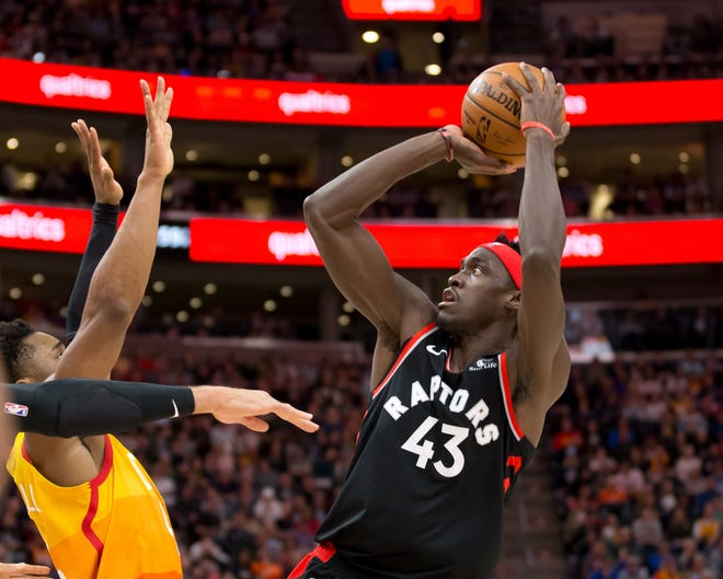 Toronto Raptors forward Pascal Siakam (43) shoots the ball against Utah Jazz guard Donovan Mitchell (45) during the first half at Vivint Smart Home Arena on March 9, 2020 in Salt Lake City.