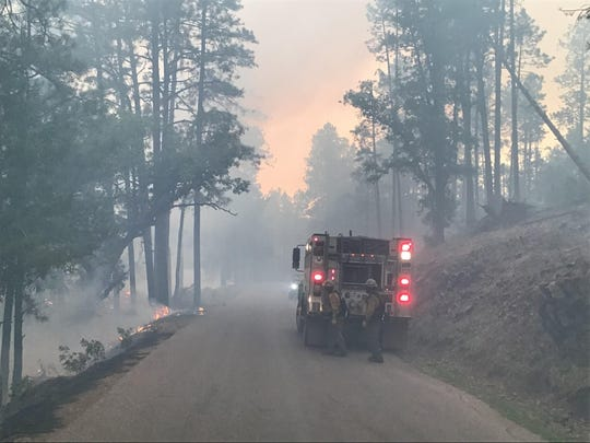 Firefighters from Silver City Engine 371 work on containing the Tadpole Fire in the Gila National Forest Tuesday, June 16, 2020.