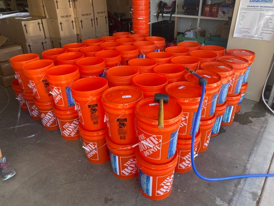 Home Depot buckets being filled with NaOClean disinfecting water. Alamogordo's NoWClean, the American distribution arm of NaOClean, donated NaOClean disinfectant water to the Navajo Nation.