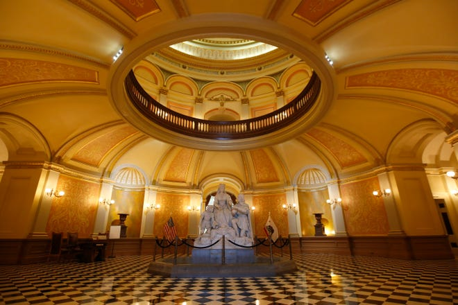 """FILE — In this March 18, 2020, file photo, a statue of Queen Isabella and Christopher Columbus stands in the rotunda of the Capitol in Sacramento, Calif. Calling Columbus """"a deeply polarizing historical figure,"""" Senate President Pro Ten Toni Atkins, D-San Diego; Assembly Speaker Anthony Rendon, D-Lakewood; and Assembly Rules Committee Chairman Ken Cooley, D-Rancho Cordova, announced Tuesday, June 16, 2020, that the controversial statue will be removed. (AP Photo/Rich Pedroncelli, File)"""