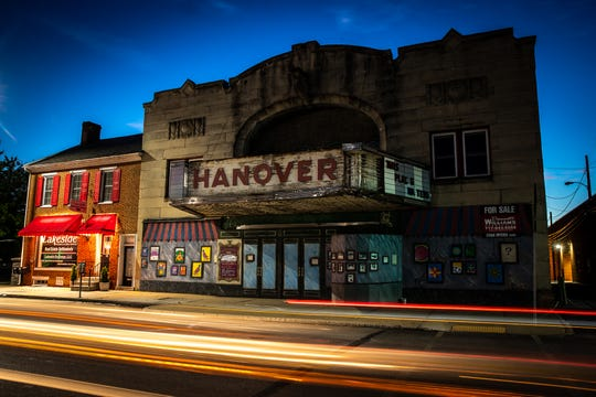 In a long exposure, the lights of cars streak past the marquee of the old Hanover State Theater, Thursday, June 11, 2020, in downtown Hanover. The theater has sat empty since it closed its doors in 1986, but was recently announced as having been purchased with an eye to restore and modernize the space.