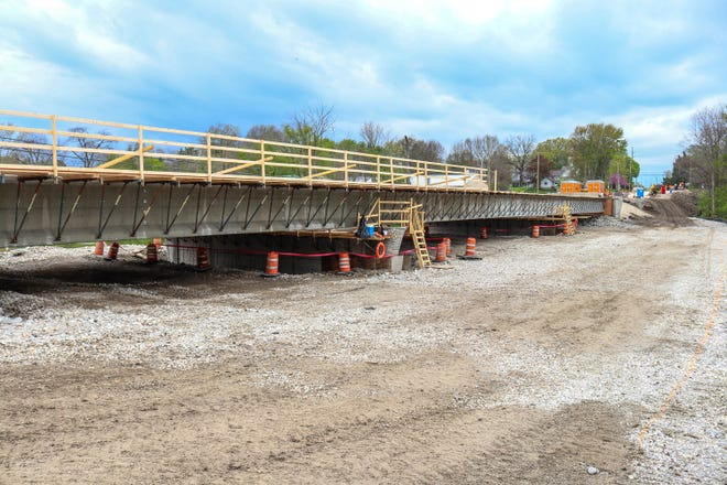 Crews make progress on the reconstruction of the Elmore bridge along Ohio 51. Work is expected to be completed later this year.