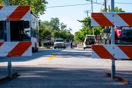 Port Huron Police respond to a crash that killed a pedestrian Wednesday, June 17, 2020, on 13th Street near Oak Street in Port Huron.