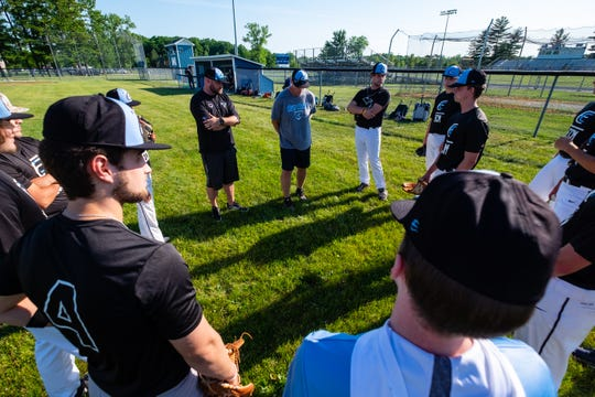 East Coast Michigan coaches Kyle Sheppard, left, and Ed Delore address the 18U team during a practice Tuesday, June 16, 2020, at Richmond High School.