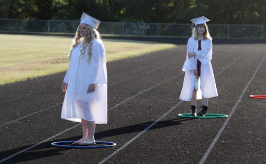 Graduates stand in hoops to maintain social distance as they wait to get their diplomas during a graduation ceremony at Webutuck High School June 16, 2020.