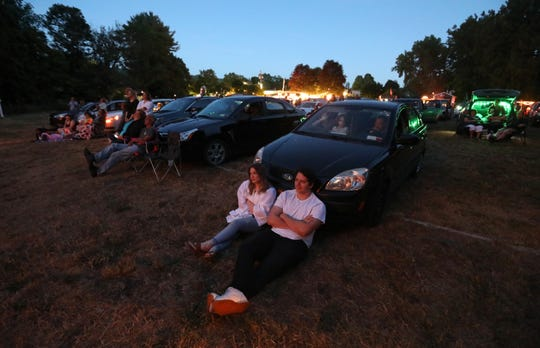 Webutuck High School graduate Kyla Turner and Salvatore Logiudice watch a video tribute to the graduates at the Four Brother's Drive-in in Amenia June 16, 2020.