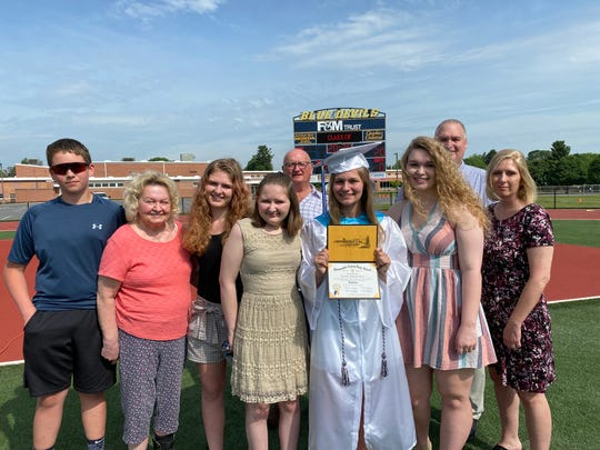 Emma Strait joined her family for sister Kristen True's graduation from Greencastle-Antrim High School. From left: cousin Brady Shiflet, grandmother Carol Smith, sister Ellie Strait, Emma, Kristen, sister Ashley True and mother Missy True. Back: grandfather Leon Smith and stepfather Jay True.