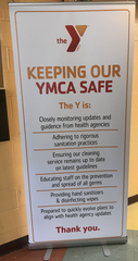 Signs displayed throughout the building at the Southern Branch YMCA to make sure people are staying safe.