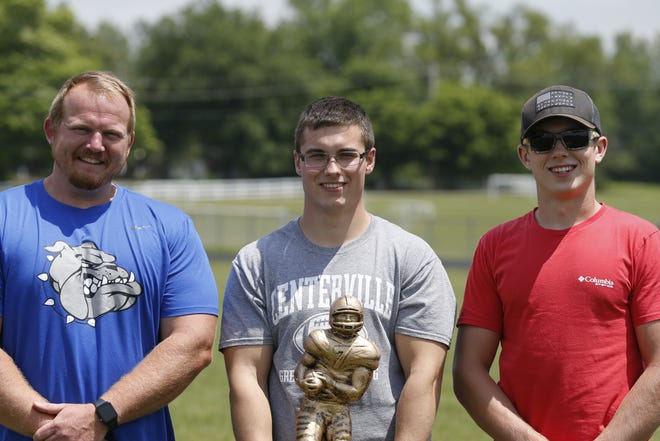Centerville High School head coach Kyle Padgett (left) and junior Brett Ballenger (right) pose with Alec Runyon (middle) after being presented with a National Football Foundation (NFF) National Scholar-Athlete Award trophy on Tuesday.