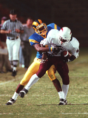 Angelo State's Chriz Brazzell tackles a West Texas A&M defender during a 1997 game.