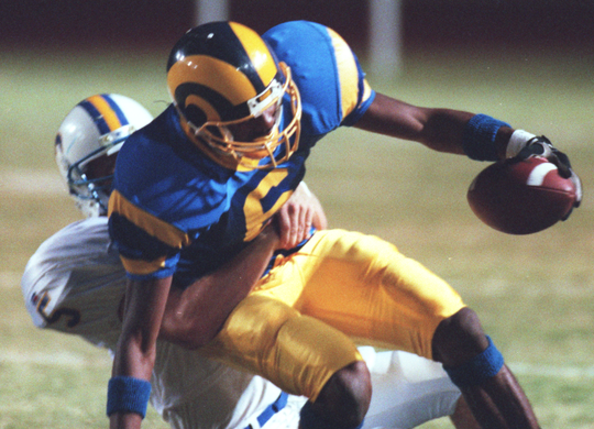 Angelo State's Chris Brazzell is tackled during a game in 1996.