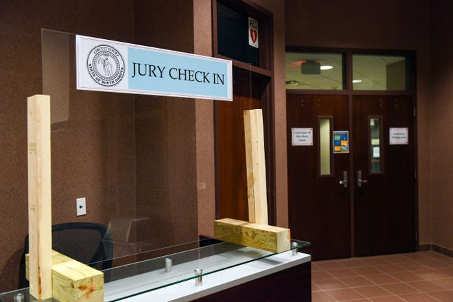 A jury check-in booth sits outside the waiting area on Wednesday, June 17, in the lobby of the Minnehaha County Courthouse in Sioux Falls.