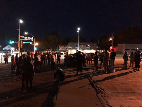 People gather about 10:30 p.m. at Ninth Avenue South and University Drive.