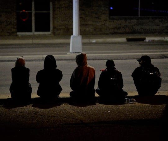 Many ndividuals went home after the Be The Community event at Ninth Avenue South and University Drive. Around 2 a.m. Wednesday, June 17, 2020, these five individuals sat on University before dispersing.