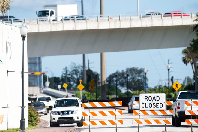 Workers from the Florida Department of Transportation are attending to a crack on the south end of the Roosevelt Bridge on Wednesday, June 17, 2020, in Stuart. Traffic across the bridge is down to two lanes, one moving northbound and one moving southbound in the northbound lanes and fishing access under the bridge is closed off. The nearby Dixie Highway bridge is closed to traffic and the Coast Guard, also on scene, warned all boating traffic to avoid passing under the bridge in a 2 a.m. warning Wednesday.