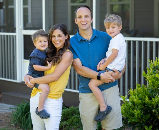 Chris Justus with his sons Mason, 4, Parker, 3, and wife Lauren.