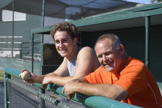 College of the Sequoias baseball coach Jody Allen, right, and his son, Payton, a Giants' baseball player, pose for a photo. Allen has coached his son the past two seasons.