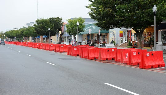 Some of the barricades that were used to create a pedestrian walkway so merchants could do business on the sidewalk because of the COVID-19 pandemic were being removed in downtown Rehoboth Beach by city crews on Wednesday morning. Some will still remain where restaurants have permission to set up on the sidewalk.