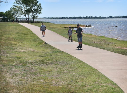Amanda O'Roark and her children, Ellison Johnson, 7, and Grayson Johnson, 11, get outside for some fresh air on the Circle Trail Wednesday.