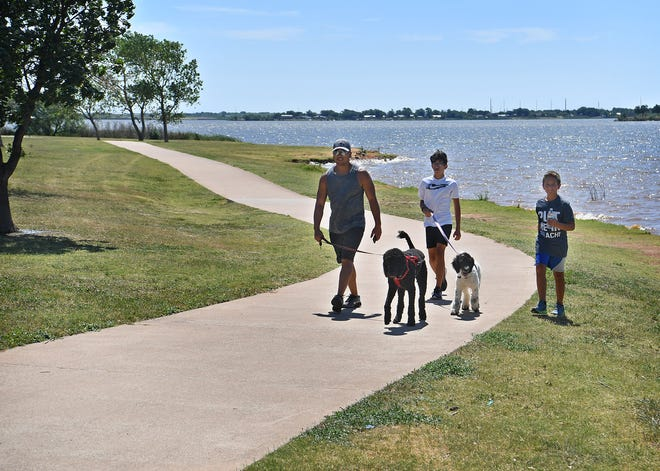 Wichita Falls residents are seen walking on the Circle Trail near Lake Wichita in this file photo. In a recent study, many smaller Texas cities report low rates of physical activity outside of work. About 66 percent of Wichitans reported being physically active in the past month.