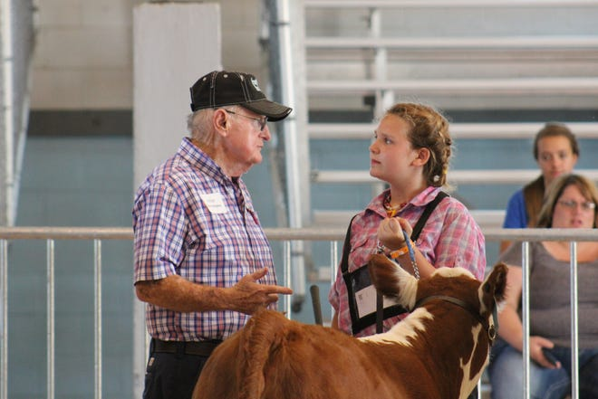 Yitta Sina listens to advice from livestock judge during the showmanship class at the Fond du Lac County Fair. Thousands of children won't be able to exhibit their 4-H projects at county fairs or the Wisconsin State Fair this summer due to concerns about COVID-19.