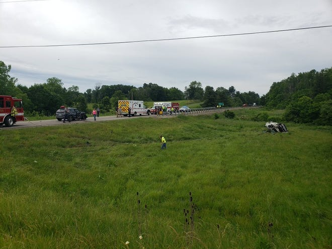 A two-vehicle crash has occurred on Roseville and Fultonrose Roads. The road is closed to traffic, and a reporter is on the scene.