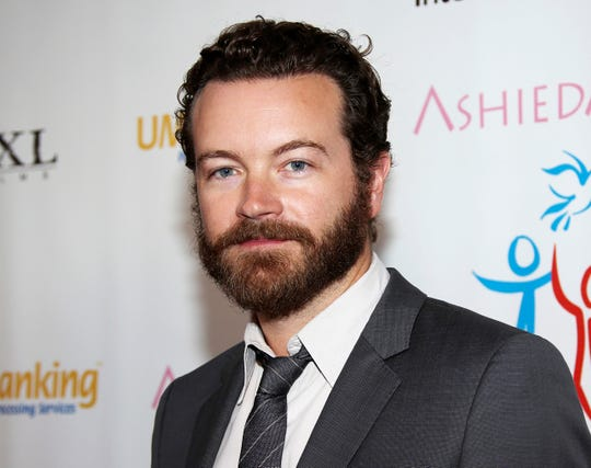 """Danny Masterson, the actorousted from Netflix's """"The Ranch"""" amid sexual assault allegations,has been charged with forcibly raping three women in separate incidents between 2001 and 2003, the district attorney in Los Angeles County announced Wednesday."""