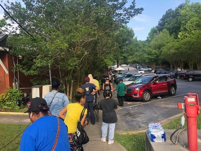 Voters wait in line at a southwest Atlanta polling place for the June 9 primary.