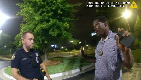Rayshard Brooks with Atlanta police officer Garrett Rolfe on June 12, 2020.