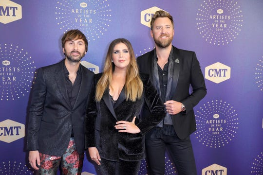 From left, Dave Haywood, Hillary Scott, and Charles Kelley of Lady Antebellum in 2019. The band now calls itself Lady A.