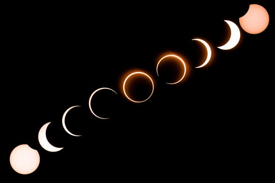"""This composite image shows the moon as it moves in front of the sun in a rare """"ring of fire"""" solar eclipse as seen from Tanjung Piai in Malaysia on Dec. 26, 2019."""