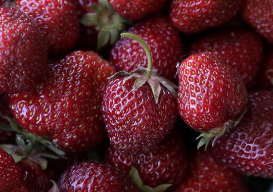 Quarts of strawberries are for sale Tuesday, June 16, 2020, at Oakridge Farms in Neenah, Wis.