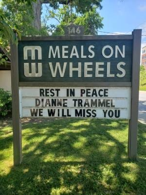 A sign marks the death of Dianne Trammel, who worked with Meals on Wheels in Buncombe County for more than 30 years.