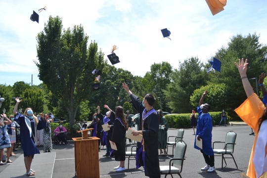 """As the DJ played """"Pomp and Circumstance,"""" 11 seniors — 10 high school and one college — walked in cap and gown to a stage set up in the parking lot of Reformed Church Home in Old Bridge and became graduates. The nursing home facility hosted a """"Senior to Senior Graduation Celebration"""" Tuesday as a gift to their student workers. Included among the surprises were photos of senior residents as high school graduates and personal appearances by school staff members."""