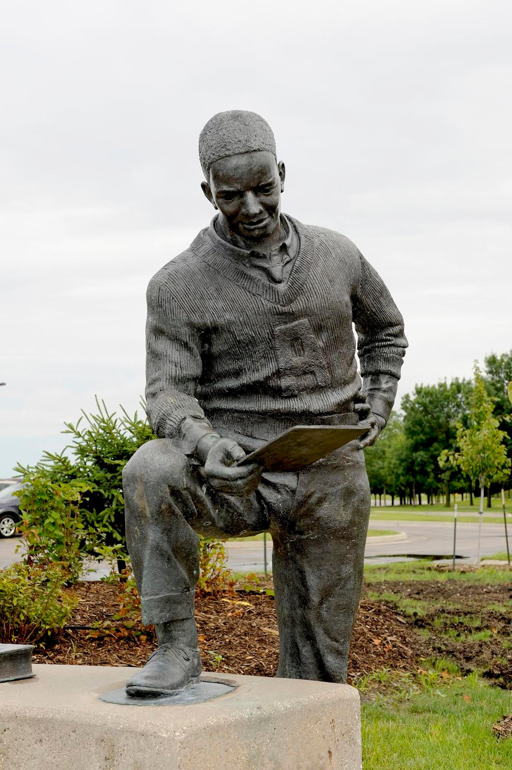 A statue of Jack Trice, Iowa State's first Black athlete, stands on the Ames campus.